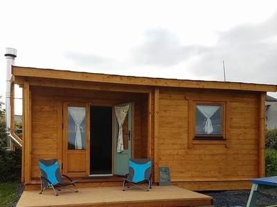Off-grid wooden cabin at Purecamping eco-retreat